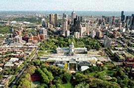 Aerial view, showing the museum's location in the Carlton Gardens and its relation to the towers of the Melbourne CBD. Image: John Gollings