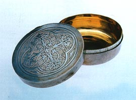 Silver pyx (c.1841-43), for consecrated bread, decorated with wheat and vine motifs, symbolic of bread and wine of the eucharist. Made by Hardman. Photos Tasmanian Museum and Art Gallery.