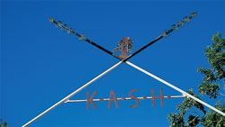 Archway of crossed spears above the KASH