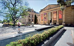 A linear pool with gentle waterfall bounds the space in front of the art gallery. Image: John Gollings