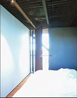 The more enclosed space of one of the bedrooms, looking out to the transparent walkway.