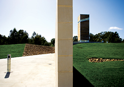 A concrete block wall severs the berm, guiding visitors from the car park to the tasting room. Image: Kraig Carlstrom