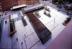The public square by EDAW, as seen from the Justice Building. Timber markers show the location of heritage structures and the site's archaeology has been retained and housed within a glass, timber and steel pavilion, also by Bates Smart. Image: Tyrone Branigan