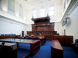 Court 12. The high-level windows of the courtrooms were unblocked and glazed in translucent glass to allow light to penetrate, prevent overlooking and reduce glare. The large volumes and ornate, hard surfaces presented significant acoustic challenges, overcome with line array loudspeaker systems.