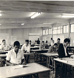 Oscar Niemeyer's studio at Brasilia, 1958. Reuben Lane is at the far left and Niemeyer is visible at the back of the studio, leaning